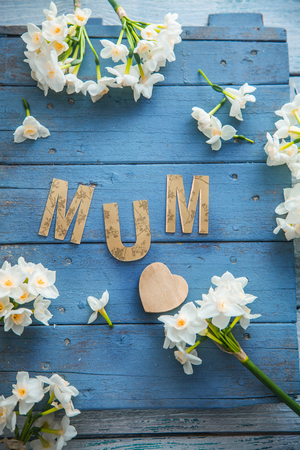 Mothers day. Narcissus flowers with letters. Spring flowers