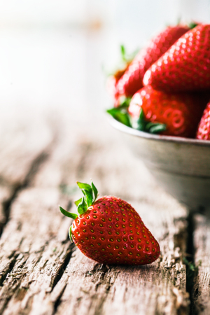 Fresh fruit. Strawberries on wood. Spring fruit. Reklamní fotografie