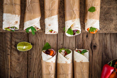 Tortilla wraps with vegetables. Mexican tortillas. Tacos with nachos and vegetables 스톡 콘텐츠