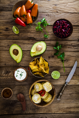Avocado and tortilla chips  with vegetables.  Tacos with nachos and vegetables
