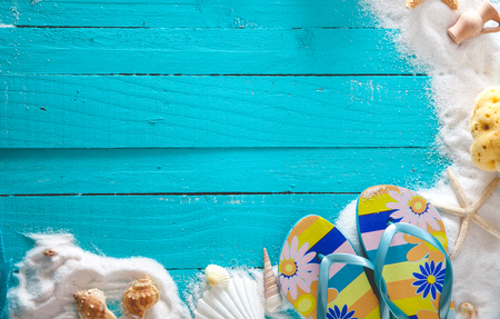 Summer background. Wooden background with white sand, starfish and seashells.