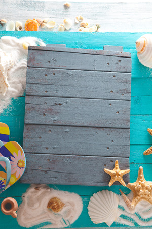 Summer background. Wooden background with white sand, seashells and starfish.