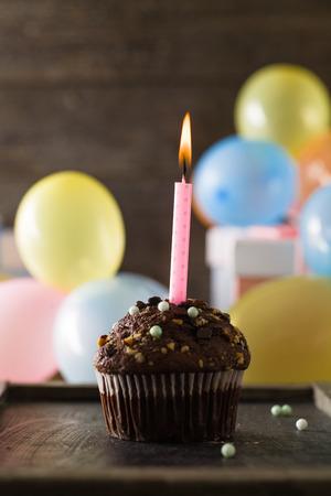 Birthday background. Birthday celebration with cupcake.