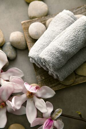 Spa and wellness. Fresh towels  with magnolia flower. Spa treatment. Overhead flatlay
