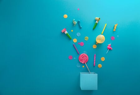 Birthday concept with gift box and confetti. Birthday balloons and candles