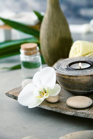 Spa and wellness. Natural setting with candle and orchid. Spa treatment.