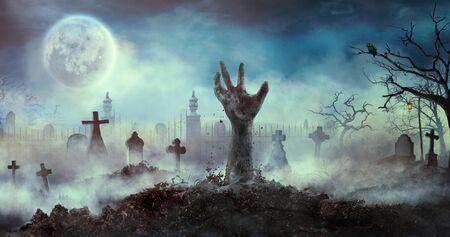 Zombiehand steigt aus dem Grab. Halloween-Design mit Zombie-Friedhof