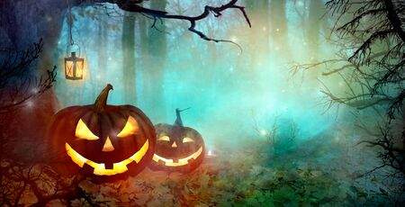 Halloween Background. Scary Pumpkins And Dark Forest. Halloween backdrop with Jack O' Lantern
