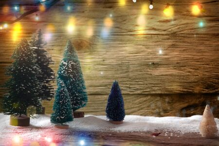 Christmas background with mini trees. Christmas festive backdrop