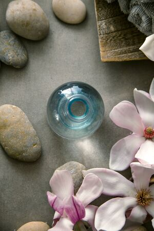 Spa and wellness. Natural massage stones  with magnolia flower .Spa treatment