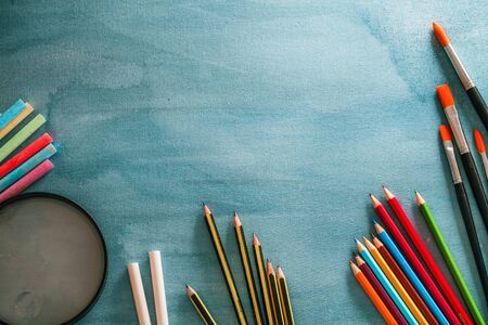 Back to school. School background with supplies. Pencils, chalk and school equipment.