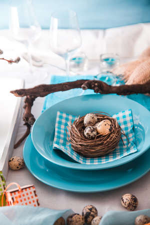 Easter table setting. Fresh eggs on plate. Spring table.
