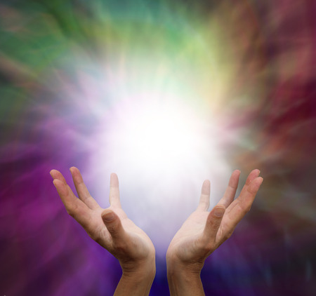 Lightworker with energy on muted colour background photo