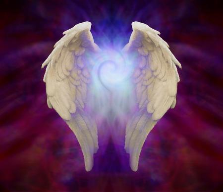 ange gardien: Ailes d'ange et Universal spirale Banque d'images
