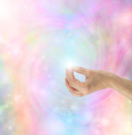 yoga to cure health: Gyan Mudra Hand Position on bright rainbow energy vortex Stock Photo