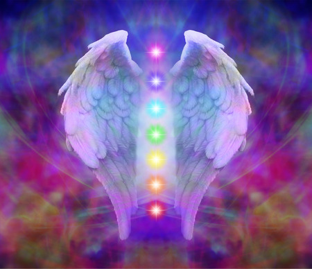 Angel wings and seven chakras on colourful background