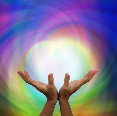 energy healing: Outstretched healing on rainbow energy colour background