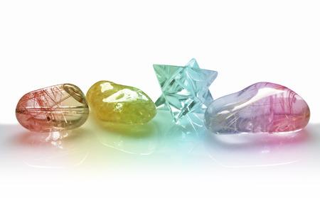 holistic healing: Four Rainbow Coloured Quartz Crystals on white background