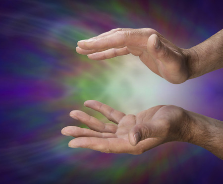 healers: Male healers hands on a coloured background