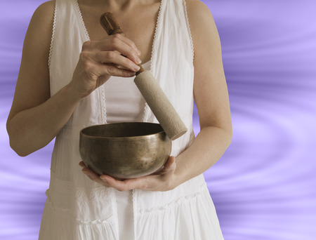 Sound Healer with Tibetan Singing Bowl Stock Photo - 28685171