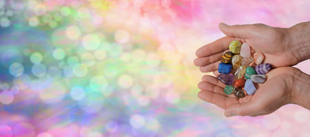 Male Crystal Healer on Rainbow Bokeh Banner Stock Photo
