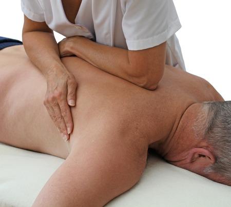 masaje deportivo: Terapeuta aplica presi�n con el antebrazo Foto de archivo