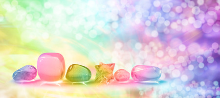 crystal therapy: Vibrant healing crystals on Bokeh banner Stock Photo