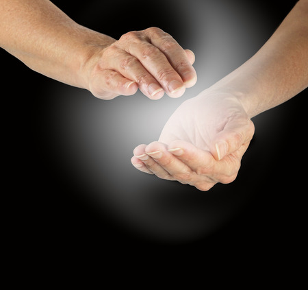 Healer s cupped hands sensing energy Stock Photo - 28684070