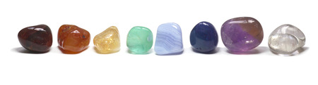 wicca: Row Of Chakra Crystals Stock Photo