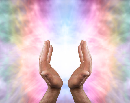 holistic health: Male hands and Angelic Healing Energy