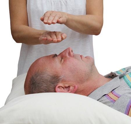 complementary therapy: Healer balancing Third Eye Chakra Stock Photo