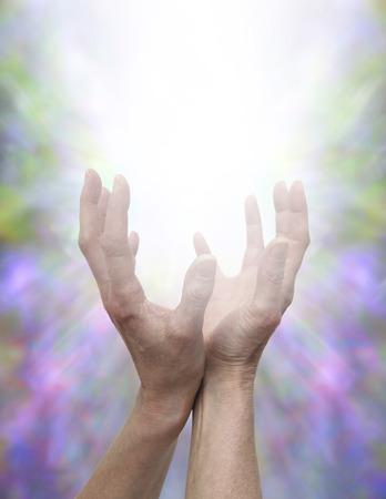 divine: Helende handen en goddelijke energie Stockfoto