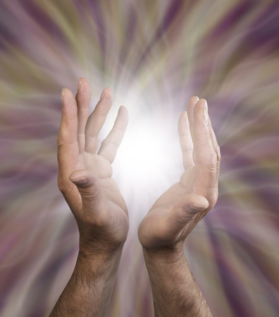 spirit new age: Male healing hands outstretched with energy field  Stock Photo