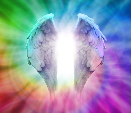 energy healing: Angel Wings on Rainbow Spiral Background Stock Photo