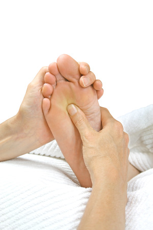 treat acupressure: Reflexology treatment on white background