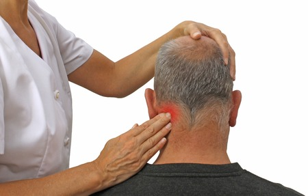 Therapist relieving pain in neck Stock Photo