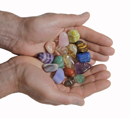 Male crystal therapist holding selection of crystal photo