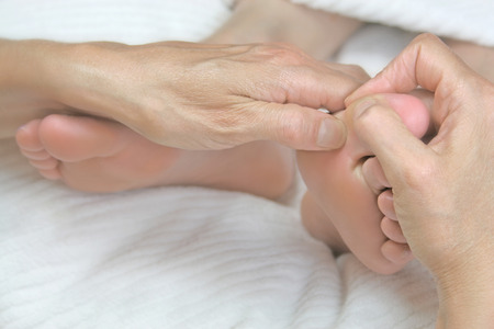 treat acupressure: Close up of Reflexology Treatment