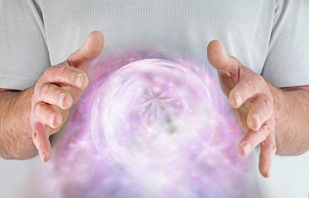 universal healer: Male healer with extraordinary ball of misty sparkling energy between his hands