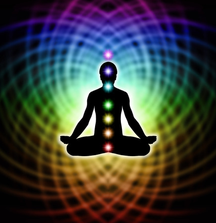 Silhouette  of a man in lotus meditation position with Seven Chakras on rainbow colored matrix energy  스톡 콘텐츠
