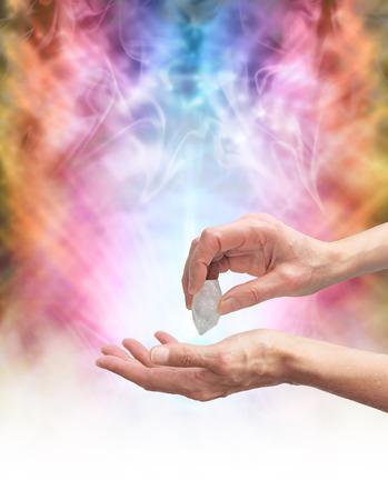 healer: Crystal healer sensing energy with terminated quartz