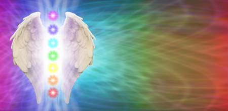 energy healing: Angel Chakra Wings on rainbow colored banner background