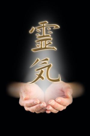 Golden Reiki Kanji Symbol and healing hands
