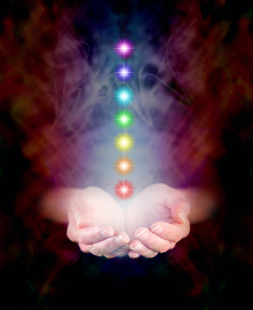 aura energy: Seven Chakras floating in Healing Hands