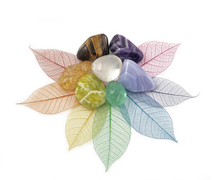 Healing Chakra Crystals on Leaves photo