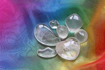 natural healing: Clear healing crystals on rainbow chiffon material