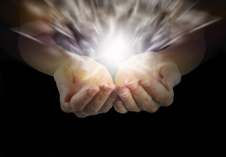 Cupped hands and vibrant energy field
