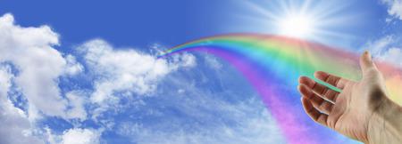 広い青い空に消えゆく虹 写真素材