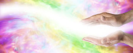 complementary therapy: Male parallel healing hands with light wave passing on colored banner background