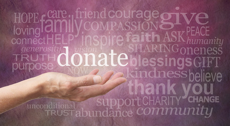 Donate Word Wall with palm up hand requesting donations Stock Photo